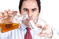 Businessman pouring  a glass of whisky Stock Image