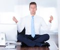 Businessman practicing yoga Royalty Free Stock Photo