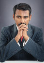 Businessman praying portrait of indian young Royalty Free Stock Photo