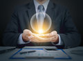 Businessman present crystal ball on hands Royalty Free Stock Photo