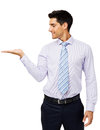 Businessman presenting invisible product young over white background vertical shot Royalty Free Stock Photos