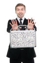 Businessman presenting a suitcase full of one hundred US dollars Royalty Free Stock Photo