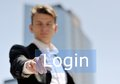 Businessman press virtual login button Royalty Free Stock Photo