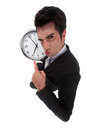 Businessman pulling a face with clock Royalty Free Stock Photos
