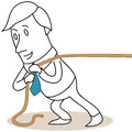 Businessman pulling a rope over his shoulder Royalty Free Stock Images