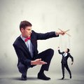 Businessman puppeteer image of young leadership concept Royalty Free Stock Images