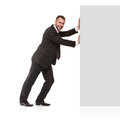 Businessman pushing away something isolated on white background Royalty Free Stock Photos