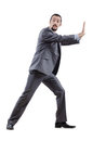Businessman pushing away virtual obstacles Stock Images