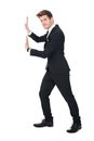 Businessman pushing invisible wall full length side view of against white background Stock Photography