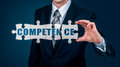 The businessman puts on the virtual puzzles word competence. The business concept.