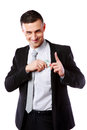 Businessman putting money in pocket happy isolated on white background Royalty Free Stock Photo
