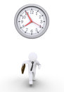 Businessman racing against time is running and a round clock Royalty Free Stock Photos