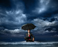 Businessman on a raft Royalty Free Stock Image