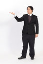 Businessman raising his hand over a white background Royalty Free Stock Photo