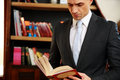 Businessman reading the book in library Royalty Free Stock Images