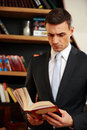 Businessman reading the book in library Royalty Free Stock Photography