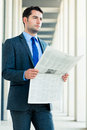 Businessman reading  business newspaper Stock Image