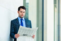 Businessman reading  business newspaper Royalty Free Stock Images