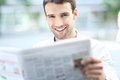 Businessman reading newspaper portrait of young business man smiling Stock Images