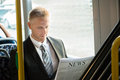 Businessman Reading Newspaper In Tram Royalty Free Stock Photo