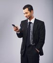 Businessman reading a text message young smiling while on phone Stock Images