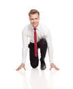 Businessman ready for chasing deals in starting position Royalty Free Stock Photos