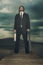 Businessman is ready for the storm coming with determined expression to stand Royalty Free Stock Images