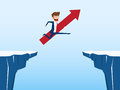 Businessman with red arrow sign jump through the gap between hill. Running and jump over cliffs. Business risk and success concept