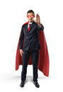Businessman in a red cape and red eye mask with one hand raised in warning on white background.
