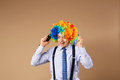 Businessman respond to numerous phone calls close up portrait of business man in clown wig business concept Royalty Free Stock Image