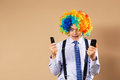Businessman respond to numerous phone calls close up portrait of business man in clown wig business concept Stock Images