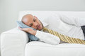Businessman resting on sofa at home elegant young Royalty Free Stock Image