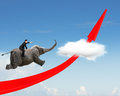 Businessman riding elephant on red arrow up trend line