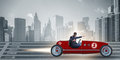 The businessman riding vintage roadster in motivation concept