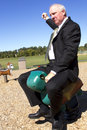 Businessman rodeo dressed in suit riding a toy turtle at a playground Stock Photo