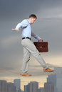 Businessman rope walker in equilibrium on a over a cityscape Royalty Free Stock Photos