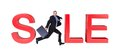 Businessman Running In Front Of Sale Sign Stock Photos