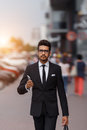 Businessman at rush hour walking in the street, in the style of motion blur. Royalty Free Stock Photo