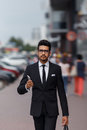 Businessman at rush hour walking in the street, in the style of motion blur with early sunlight Royalty Free Stock Photo