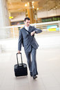 Businessman rushing in airport Royalty Free Stock Photography
