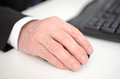 Businessman s hand holding a computer mouse closeup Royalty Free Stock Image
