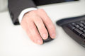 Businessman s hand holding a computer mouse closeup Stock Photography