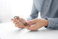 Businessman's hand holding key. Key Business Solutions. Business concept of success.