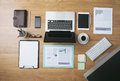 Businessman s tidy desktop and work tools with paperwork computer touch screen devices and stationery on a wooden surface top view Stock Photography