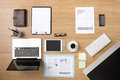 Businessman s tidy desktop and work tools with paperwork computer touch screen devices and stationery on a wooden surface top view Stock Photos