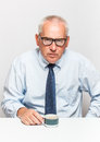 Businessman sad old with coffee Stock Photography