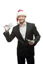 Businessman in santa hat holding money Royalty Free Stock Photography