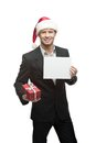 Businessman in santa hat holding sign Royalty Free Stock Photo