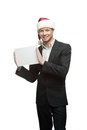 Businessman in santa hat holding sign Royalty Free Stock Photography