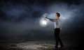Businessman in search in darkness young walking with lantern Royalty Free Stock Images